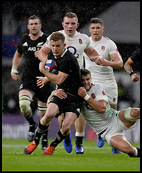 November 10, 2018 - London, London, United Kingdom - England face the All Blacks at Twickenham Stadium during the Quilter Internationals 2018. New Zealand Damian McKenzie is tackled by England's Henry Slade  during the Quilter Internationals 2018 game at Twickenham  (Credit Image: © Andrew Parsons/i-Images via ZUMA Press)