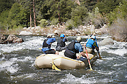 Whitewater rafting, back view