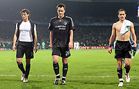 Photo: Paul Thomas.<br /> Werder Bremen v Chelsea. UEFA Champions League, Group A. 22/11/2006.<br /> <br /> (L_R) Dejected chelsea players Khalid Boulahrouz, John Terry and Joe Cole.