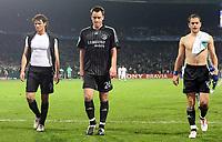 Photo: Paul Thomas.<br /> Werder Bremen v Chelsea. UEFA Champions League, Group A. 22/11/2006.<br /> <br /> (L_R) Dejected chelsea players Khalid Boulahrouz, John Terry and Joe Cole.