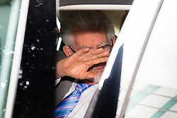 London, June 26th 2014. Entertainer and artist Rolf Harris shields his face from photographers as he leaves Southwark Crown Court after a sixth day of waiting for the jury's verdict on the 12 counts of indecent assault against 4 girls aged 7- 16 that he faces.