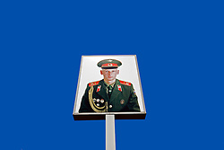 Detail of portrait of Russian soldier at Checkpoint Charlie in central Berlin Germany