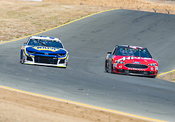 June 22, 2018 - Sonoma, CA, U.S. - SONOMA, CA - JUNE 22:  Chase Elliott, driving the #(9) Chevrolet for Hendrick Motorsports and Kurt Busch, driving the negotiate turn 8 on Friday, June 22, 2018 at the Toyota/Save Mart 350 Practice day at Sonoma Raceway, Sonoma, CA (Photo by Douglas Stringer/Icon Sportswire) (Credit Image: © Douglas Stringer/Icon SMI via ZUMA Press)