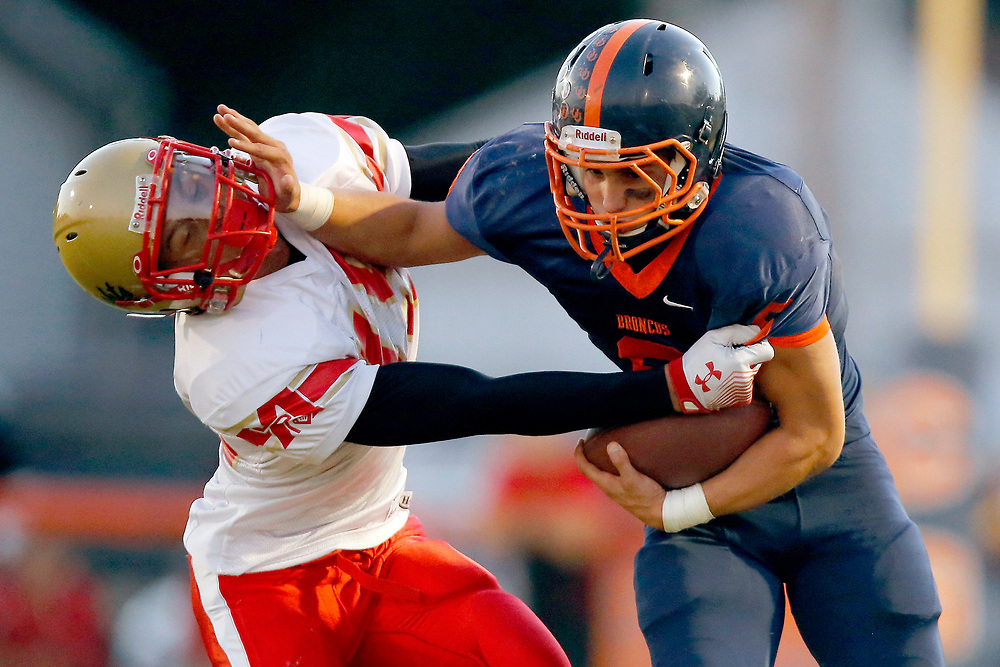 Cerro Gordo/Bement's Steve Isbell (6) tries to hold off a tackle from Arthur-Lovington/Atwood-Hammond's Jordan Feagin (15) during the first half of a game at Cerro Gordo High School Friday, Sept. 13, 2013 in Cerro Gordo, Ill. (STEPHEN HAAS)