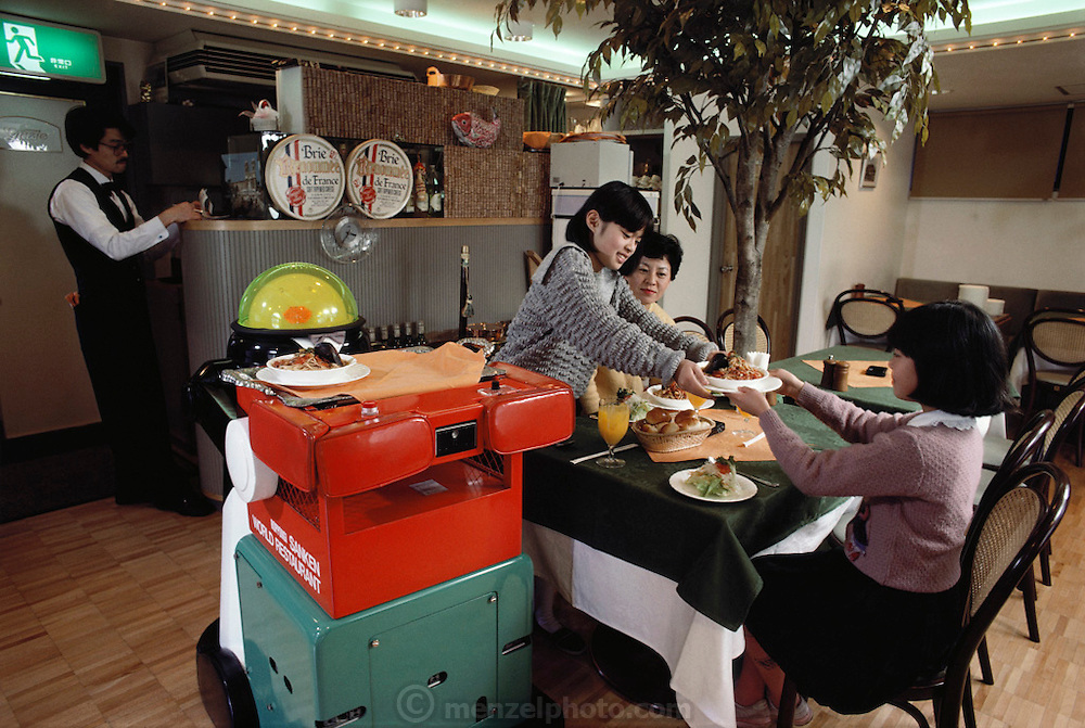 A robotic waiter rolls up with an order of spaghetti and clams at a Tokyo, Japan restaurant. MODEL RELEASED.