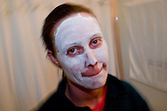 A young woman uses a mask to keep hear face clean and healthy.