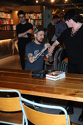 "March 22, 2019 - London, United Kingdom - Frank Turner signs copies of his book ""Try This At Home"" at Waterstones Tottenham Court Road in London. (Credit Image: © Terry Scott/SOPA Images via ZUMA Wire)"
