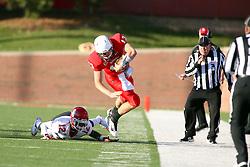 15 October 2011: Alphonso Valdez strikes at Matt Brown during an NCAA football game between the University of South Dakota Coyotes and the Illinois State Redbirds (ISU) at Hancock Stadium in Normal Illinois.
