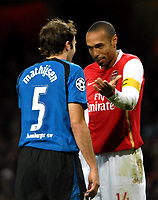 Photo: Ed Godden.<br /> Arsenal v Hamburg. UEFA Champions League, Group G. 21/11/2006. Thierry Henry has words with Hamburg's Joris Mathisen.
