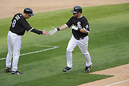 CHICAGO - SEPTEMBER 5:  Third base coach Jeff Cox #8 greets Mark Kotsay #30 of the Chicago White Sox after Kotsay hit a home run against the Boston Red Sox on September 5, 2009 at U.S. Cellular Field in Chicago, Illinois.  The White Sox defeated the Red Sox 5-1.  (Photo by Ron Vesely)