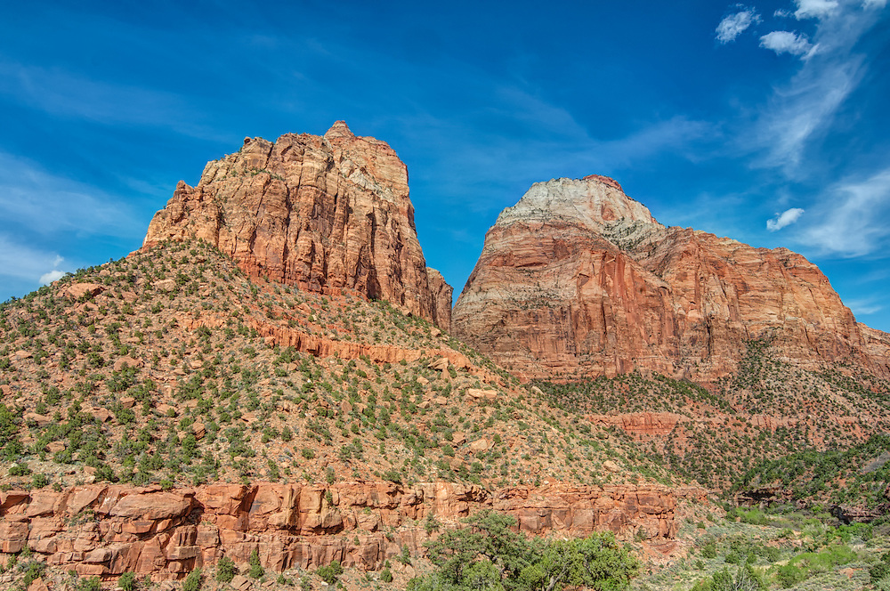 Mount Spry and East Temple are two of the landmark rock formations of Zion National Park in southwestern Utah. On this warm late spring afternoon, the snow is gone and the sun is shining on a spectacularly clear day.