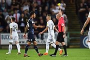 Lewis Baker (34) of Leeds United is shown a yellow card during the EFL Sky Bet Championship match between Swansea City and Leeds United at the Liberty Stadium, Swansea, Wales on 21 August 2018.