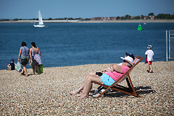 © Licensed to London News Pictures. 21/06/2014. Southsea, Hampshire, UK. People enjoying the sunny weather by the seaside in Southsea, Hampshire today (21st June 2014). The weather in the UK over the weekend is set to be warm and sunny. Photo credit : Rob Arnold/LNP