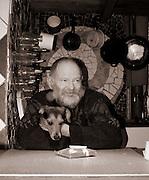man with grey beard cuddling his dog
