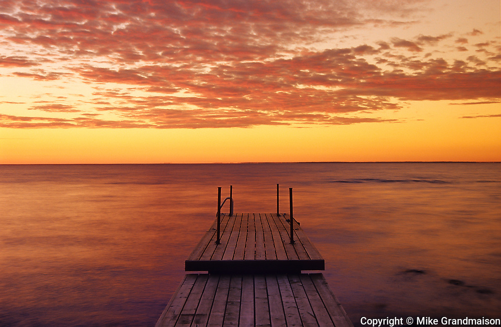 Dock on Lake of teh Woods at sunrise<br />Buffalo Point<br />Manitoba<br />Canada