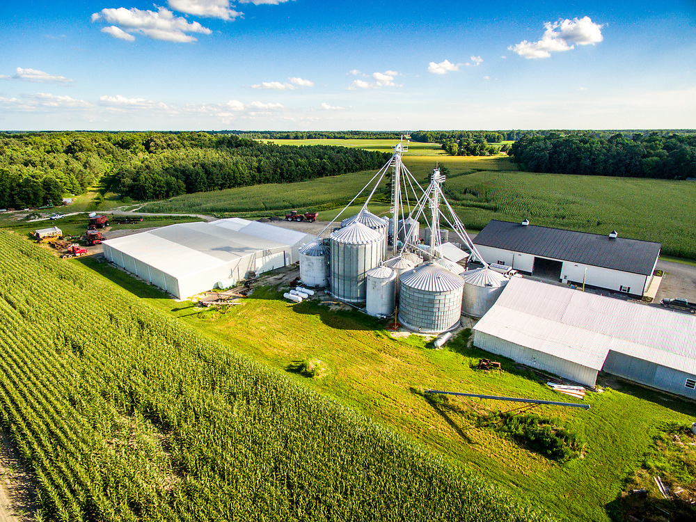 Aerial view of large grain bins located on a farm in Federalsburg, Maryland.