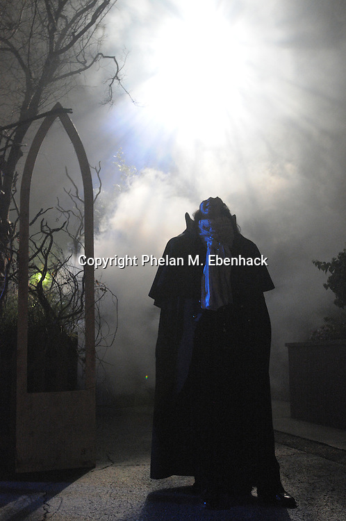 The Headless Horesman walks through the fog in the outdoor American Gothic venue during a dress rehearsal of Universal Studios Florida's Halloween Horror Nights in Orlando, Fla., Tuesday, Sept. 16, 2008.
