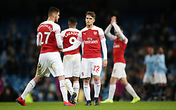 Arsenal's (left-right) Konstantinos Mavropanos and Denis Suarez react after the final whistle during the Premier League match at the Etihad Stadium, Manchester.