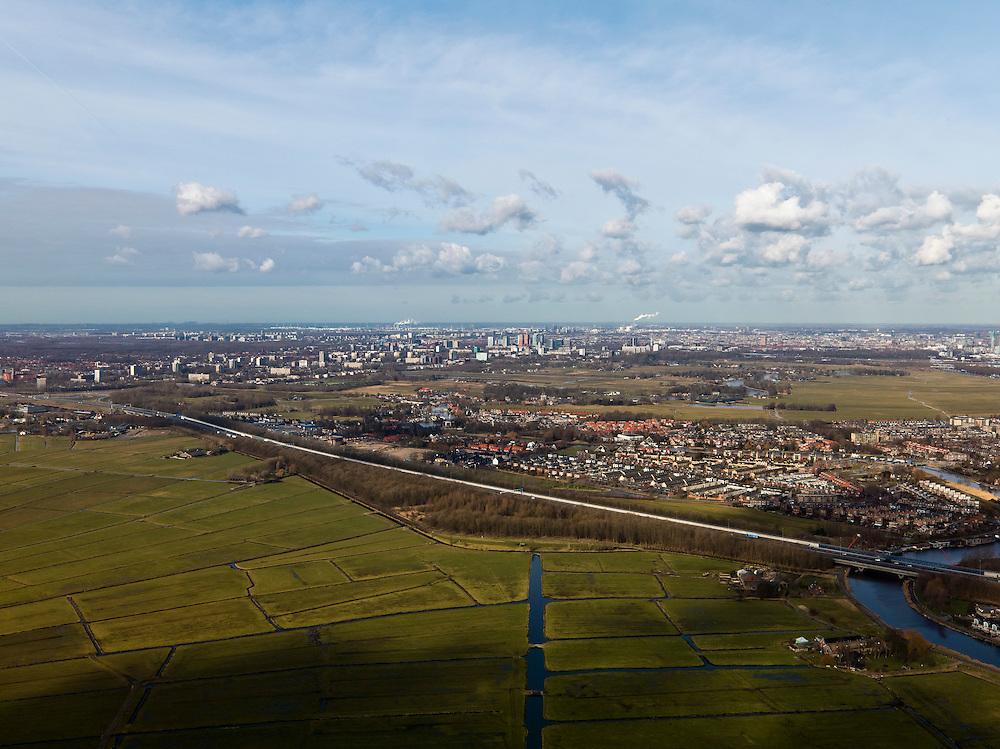 Nederland, Noord-Holland, Gemeente Ouder-Amstel, 20-02-2012; Polder De Ronde Hoep, Rijksweg A9 en Ouderkerk. De polder is een van de grootste onbebouwde veenweidegebieden van de Randstad met karakteristiek stervormig kavelpatroon. Dit slotenpatroon van gerende verkaveling is ontstaan in de middeleeuwen ten tijde van de ontginning van het laagveen  (er is ontgonnen vanuit en loodrecht op de omringende riviertjes Amstel, Bullewijk, Waver. Aan de horizon Amstelveen, Amsterdam Zuid-as en Amsterdam Zuid-Oost..Polder Round Hoep, one of the largest undeveloped pasture area's in the Randstad with characteristic star-shaped pattern. This pattern is the result of the extraction during the Middle Ages. Skyline Amsterdam at the horizon.luchtfoto (toeslag), aerial photo (additional fee required).copyright foto/photo Siebe Swart