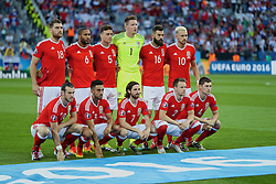 TOULOUSE, FRANCE - Monday, June 20, 2016: Wales players line up for a team group photograph before the final Group B UEFA Euro 2016 Championship match against Russia at Stadium de Toulouse. Back row L-R: Sam Vokes, captain Ashley Williams, James Chester, goalkeeper Wayne Hennessey, Joe Ledley, Aaron Ramsey. Front row L-R: Gareth Bale, Neil Taylor, Joe Allen, Chris Gunter, Ben Davies. (Pic by David Rawcliffe/Propaganda)