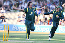 © Licensed to London News Pictures. 08/03/2012. Adelaide Oval, Australia. Australian bowler Clint McKay celebrates after bowling out Sri Lankan captain Mahela Jayawardena during the One Day International cricket match final between Australia Vs Sri Lanka. Photo credit : Asanka Brendon Ratnayake/LNP