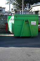 Glass recycling container at the local county council Glasthule recycling centre in Dublin Ireland
