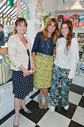 Left to right, HARRIET HASTINGS co-founder of Biscuiteers, VICTORIA PILKINGTON and her daughter JESSE PILKINGTON at a party to launch Biscuiteers Fashion Biscuit Collection inspired by Alice Naylor-Leyland's wardrobe held at Biscuiteers, 194 Kensington Park Road, London W11 on 23rd June 2015.