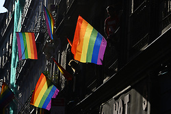 July 4, 2018 - Madrid, Madrid, Spain - Gay Pride rainbow coloured flags decorate balconies of a building in the Chueca district, a popular area for the gay community in Madrid. (Credit Image: © Jorge Sanz/Pacific Press via ZUMA Wire)