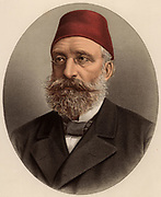 Midhat Pasha (1822-1883), Turkish politician, governor of Bulgaria (1864-1869).  In 1876 he led the revolution deposing the tyrant Abd-al-Aziz. In 1883 he was charged with the murder of Abd-al-Aziz, imprisoned and strangled. From 'The Modern Portrait Gallery' (London, c1880).