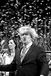 Competitive eater, impersonating Donald Trump enter the arena ahead of the Wing Bowl XXIV chicken wing eating contest at Wells Fargo Center in Philadelphia, PA., on February 5, 2016.