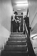 A police officer and three other figures standing at the top of the stairs, St. Phillips, Bristol, UK, January, 2012