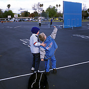 Old friends..........Bryce finds his friend, Casey, with whom he attended kindergarten on the playground of Haynes Elementary School. Bryce attended Haynes the previous year before being pulled out for homeschool. Jeanne takes her sons to the playground after school adjourns so they can play with their friends.