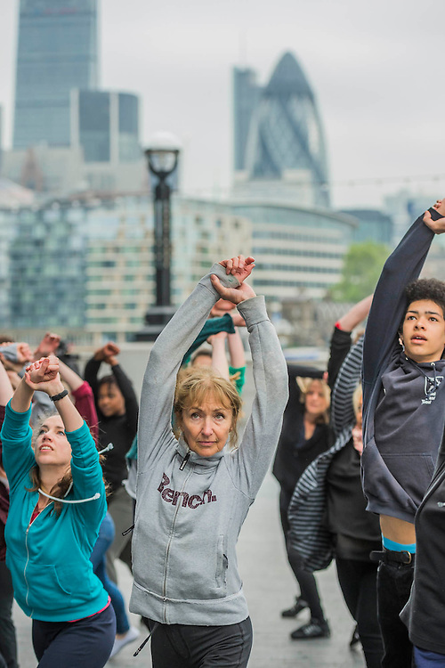Warminfg up - The Mayor of London Sadiq Khan joined choreographer Akram Khan and Londoners as they warmed-up at City Hall for the international Big Dance Pledge. On Friday 20 May, over 40,000 people in 43 countries around the world will take part in the Big Dance event, which has been specially choreographed by Akram Khan. Among the Londoners were: Students from University of Roehampton; MovE17 community group; Children from John Scurr Primary School; and the Croydon Community Dance group. This year is the finale of Big Dance, celebrating ten years of grassroots and community dance.