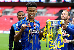 Lyle Taylor of AFC Wimbledon celebrates with the League Two Trophy - Mandatory by-line: Robbie Stephenson/JMP - 30/05/2016 - FOOTBALL - Wembley Stadium - London, England - AFC Wimbledon v Plymouth Argyle - Sky Bet League Two Play-off Final