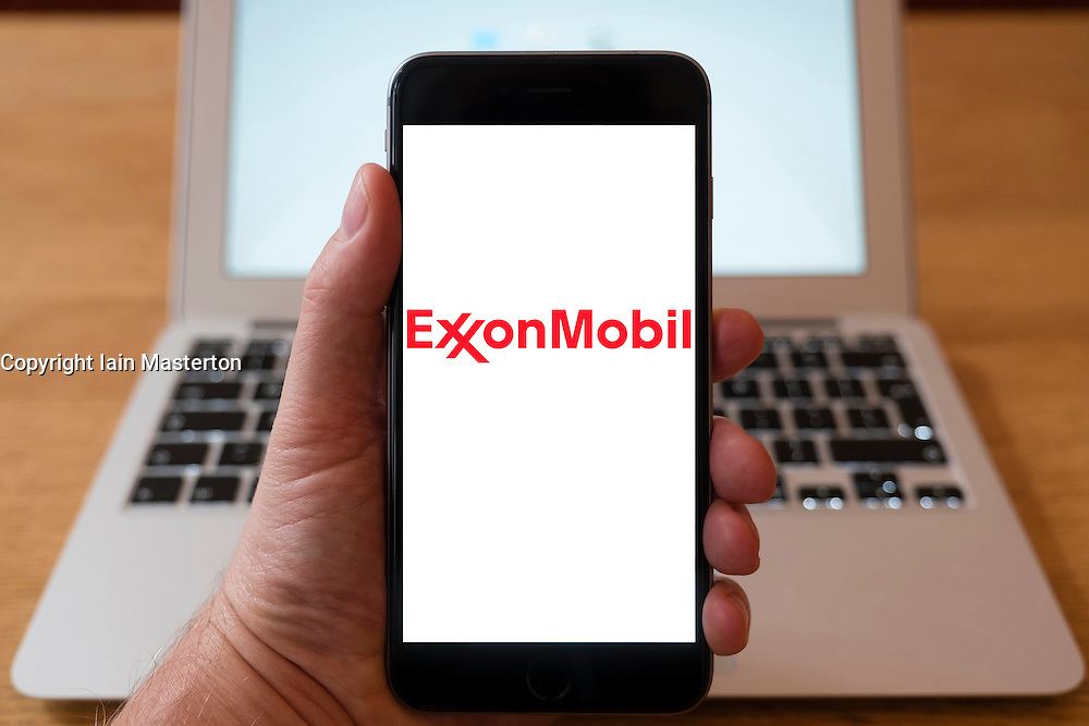 Using iPhone smartphone to display logo of Exxonmobil oil and gas major