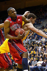 March 16, 2011; Berkeley, CA, USA;  Mississippi Rebels guard Zach Graham (32) grabs a rebound from California Golden Bears forward Harper Kamp (22) during the first half of the first round of the National Invitation Tournament at Haas Pavilion. California defeated Mississippi 77-74.