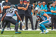 Sunday, October 6, 2019; Charlotte, N.C., USA;  Carolina Panthers running back Christian McCaffrey (22) runs with the ball while Jacksonville Jaguars linebacker Quincy Williams (56) prepares to tackle during an NFL game at Bank of America Stadium. The Carolina Panthers beat the Jacksonville Jaguars 34-27. (Brian Villanueva/Image of Sport)