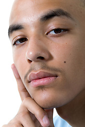 Teenaged boy looking thoughtful,