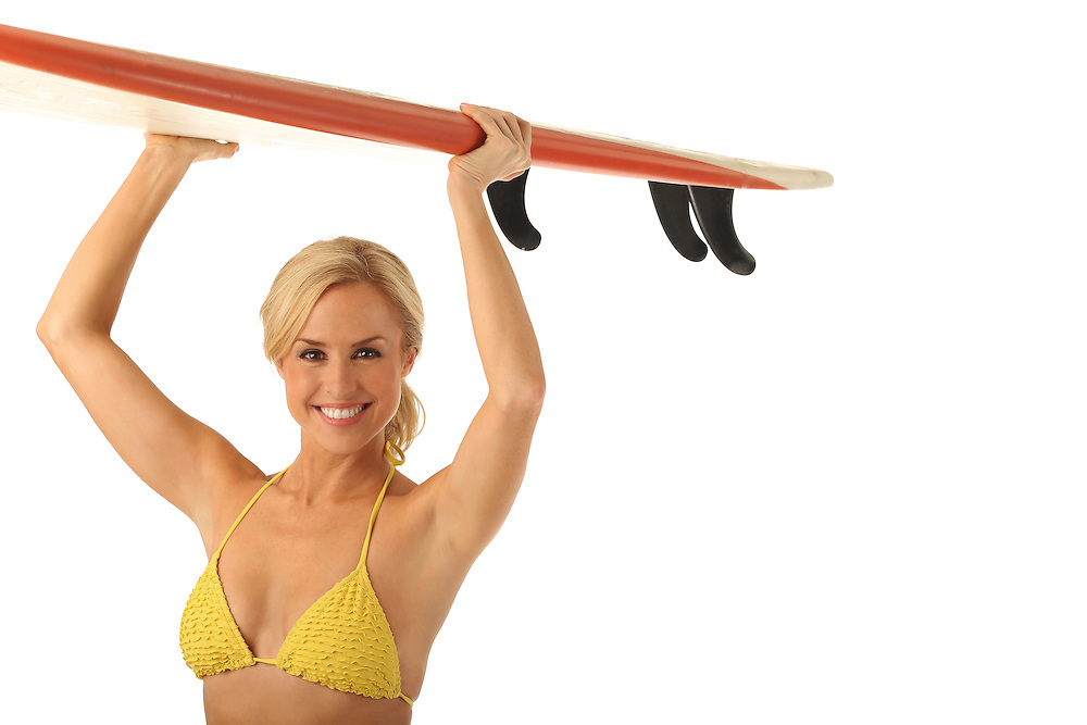 Lauren Thompson with surfboard.