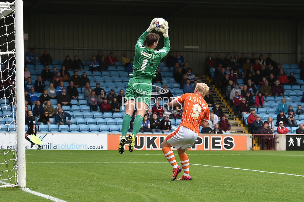 Luke Daniels just makes the save before Mark Cullen gets to the ball during the Sky Bet League 1 match between Scunthorpe United and Blackpool at Glanford Park, Scunthorpe, England on 5 September 2015. Photo by Ian Lyall.