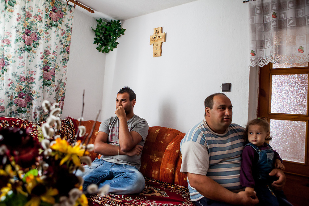 """David Korckovsky with his father and the daughter of his sister at the house of his parents .David grew up at the Roma settlement """"Podsadek"""" and he is the first Roma from the settlement who made it to University and finished in 2016 social work with a MA degree."""