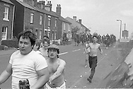 Miners being chased by mounted police at Orgreave during the 1984 strike. 18 June 1984. &copy; Martin Jenkinson Image Library<br /> NUJ recommended terms &amp; conditions apply. Copyright Designs &amp; Patents Act 1988. Moral rights asserted credit required. No part of this photo to be stored, reproduced, manipulated or transmitted by any means without prior written permission.