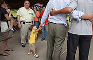 Two-year-old Reed Foley grabs his father Tom Foley's hand during the  Waterbury Ponte Feast Saturday August 2, 2014 in Waterbury, Conn.  Foley, the endorsed Republican candidate for Connecticut governor was campaigning at the Feast.   CREDIT: Michelle McLoughlin for The Wall Street Journal