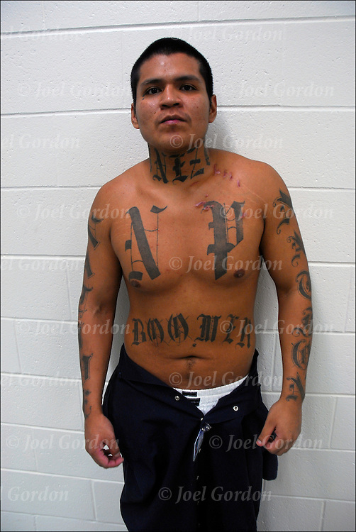 Orange County Jail - Inmate with gang tattoos FPSC ( Familia Para Siempre Clique ).N.P. Chest ( Native Pride)  Native Nation Right left arm  / Neck ( East Side) Both side of neck. Gang from East Side. Back Female 100% (Navajo) Boomer (X on the O's disrespect towards and Oriental gang) nickname &quot;Boomer&quot;.<br /> <br /> Release #2040
