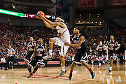 November 30, 2013: Terran Petteway (5) of the Nebraska Cornhuskers goes for a lay up with Dontel Highsmith (4) of the Northern Illinois Huskies grabbing on at the Pinnacle Bank Areana, Lincoln, NE. Nebraska defeated Northern Illinois 63 to 58.