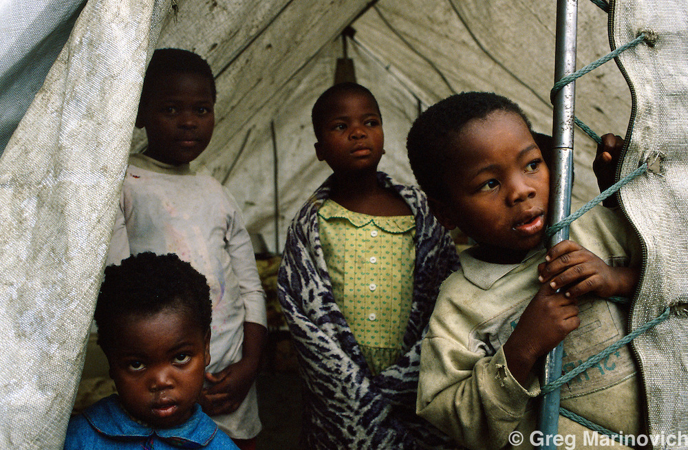 Sonkombo, KwaZulu Natal, 1994, South Africa: A family prepares to return to Sonkombo after living in a refugee camp for  ANC supporting families who fled from the Sonkombo area from which they had fled months earlier because of attacks by rival IFP.