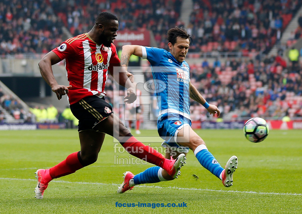 Victor Anichebe (l) of Sunderland and Charlie Daniels of Bournemouth during the Premier League match at the Stadium Of Light, Sunderland<br /> Picture by Simon Moore/Focus Images Ltd 07807 671782<br /> 29/04/2017