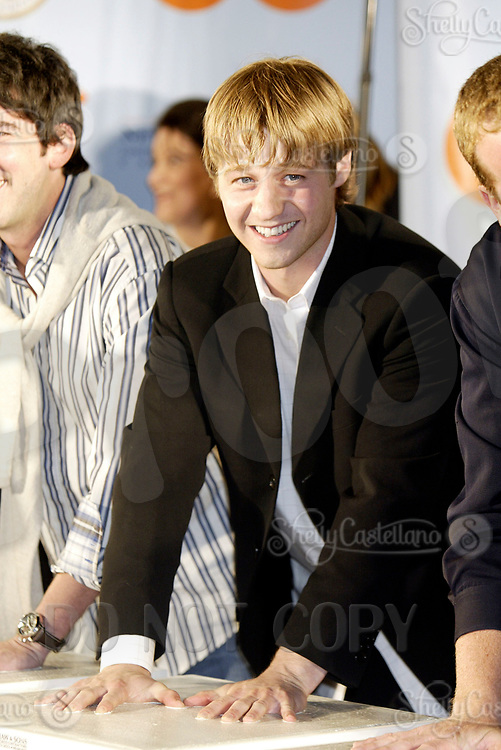 Oct 28, 2004; Newport Beach, CA, USA; Cast Member BENJAMIN MCKENZIE who plays Ryan on the FOX hit TV show 'The OC' visited the Balboa Penninsula in Newport Beach to get a Key to the City and be immortalized in cement with thier hand prints to be placed at the enterance to the Historic Balboa Pavillion.  Mandatory Credit: Photo by Shelly Castellano/ZUMA Press.