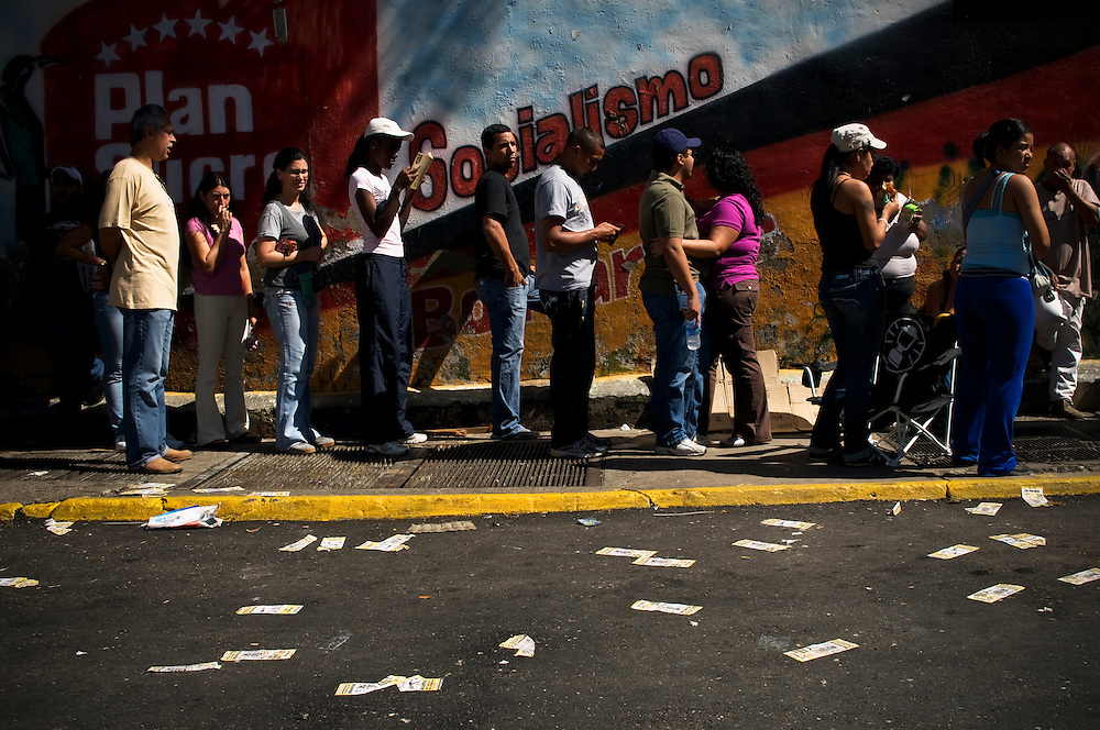 Venezuelans wait in line to vote at a polling center in Petare, a slum on the outskirts of Caracas, Venezuela on Sunday, September 26, 2010.  Venezuelans went to the polls today to elect their 165-seat national assembly, which is currently monopolized by supporters of Hugo Chávez. Although Chávez remains popular among constituents living in the slums, their support is wavering due to increases in crime, inflation, food and electricity shortages. Most voters waited in line for several hours to cast their ballot.