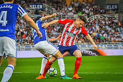 April 19, 2018 - San Sebastian, Spain - Saul Niguez of Atletico Madrid duels for the ball with Ruben Pardo of Real Sociedad during the Spanish league football match between Real Sociedad and Atletico Madrid at the Anoeta Stadium on 19 April 2018 in San Sebastian, Spain  (Credit Image: © Jose Ignacio Unanue/NurPhoto via ZUMA Press)